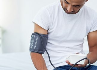 male monitoring blood pressure | what to do about high blood pressure