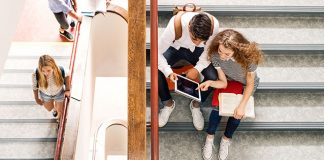 Students studying on a staircase