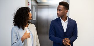 Two people having a conversation in front of the elevator | example elevator pitch for college students