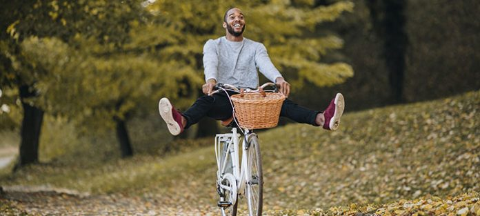 happy male cruising on bike