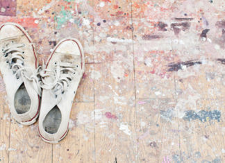 Shoes on floor of paint