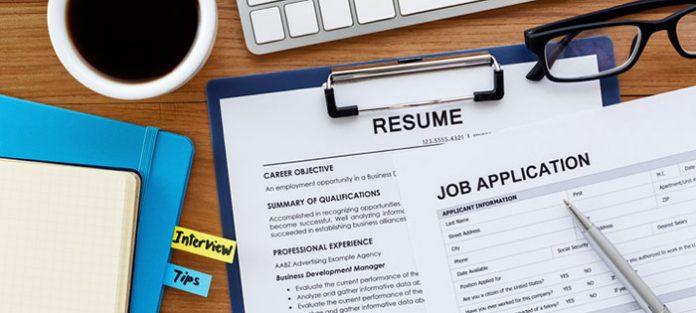 resume and job application on desk
