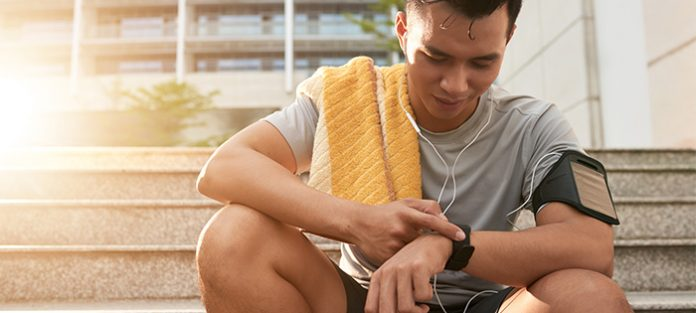 male looking at fitness watch