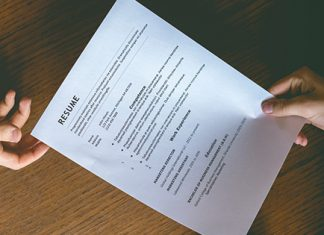 resume being passed between two people