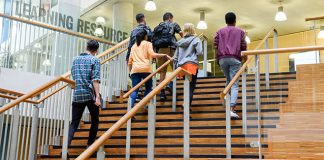 students climbing stairs to resource center