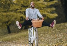 Happy guy riding a bike