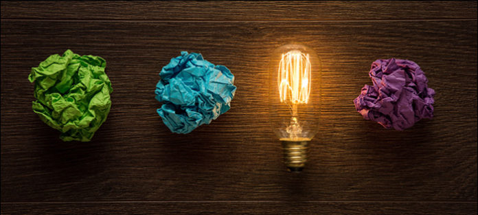 crumpled pieces of paper and lightbulb