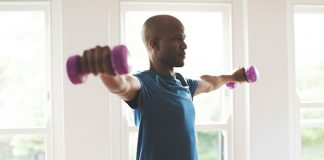 Guy lifting weights in home