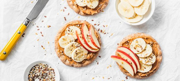 rice cakes with peanut butter, apple, and banana