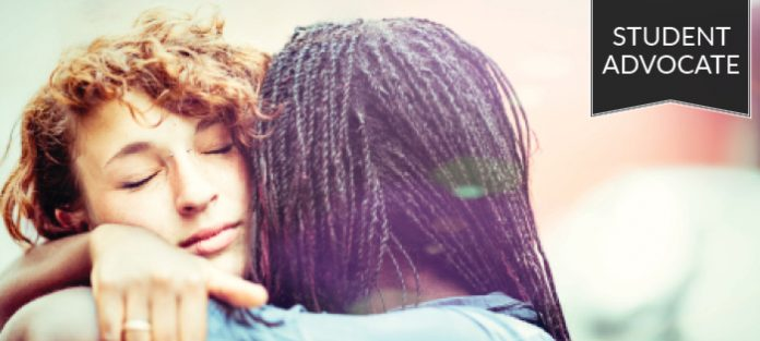 Student advocate: Two girls hugging