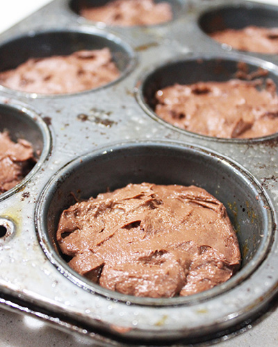 brownie batter in muffin pan
