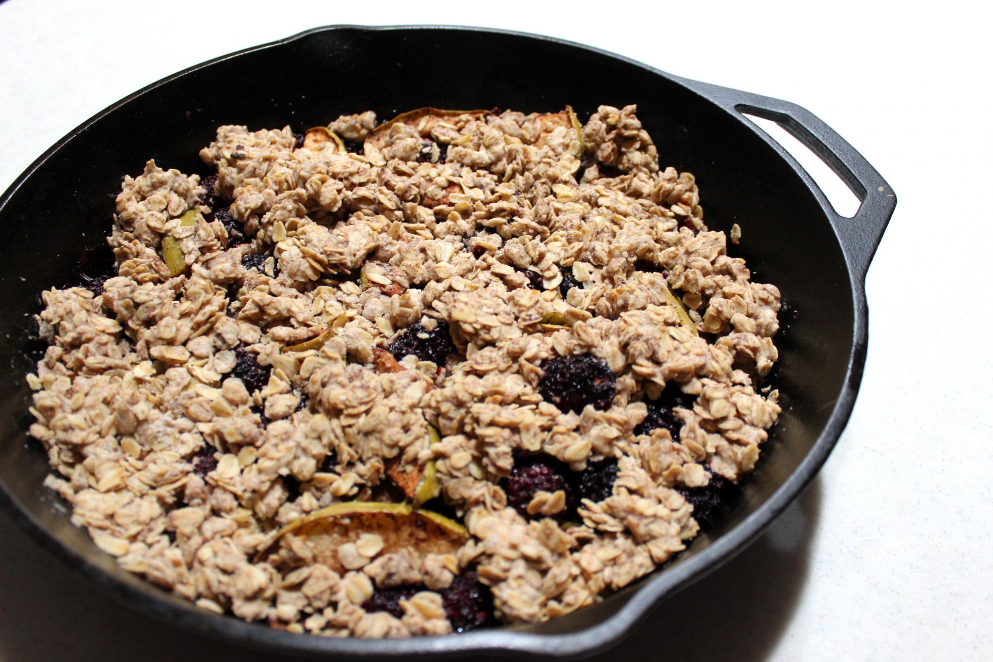 oats, apples, and blackberries in skillet