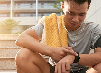 sweaty guy checking his watch