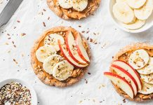 rice cakes with peanut butter, apples, and bananas