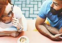 man and woman talking over coffee