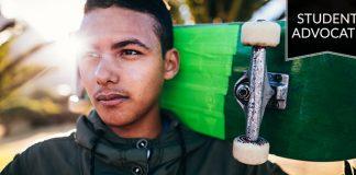 Student advocate: Pensive boy holding skateboard