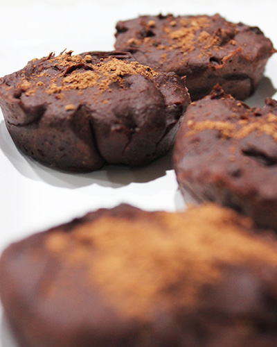 freshly baked brownies topped with cocoa powder