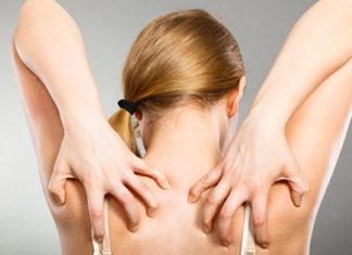 Woman scratching back