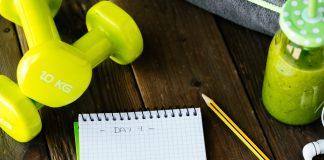 dumbbells and notepad