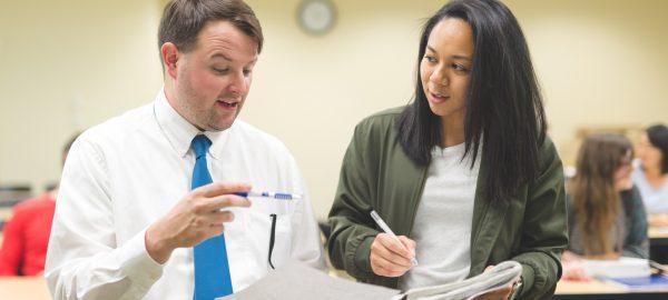 Student talking to teacher