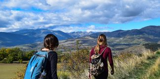 Two-female-college-students-hiking
