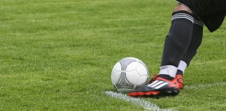 Young-man-playing-soccer