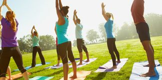 students-doing-yoga-outside