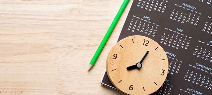 Clock on top of calendar