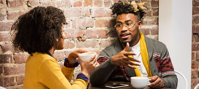 guy and girl talking over coffee