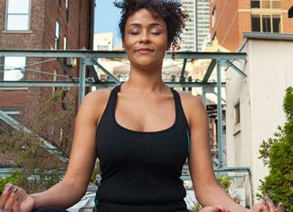 Woman meditating outside