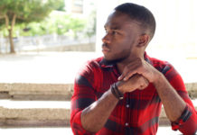 pensive young black man