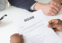 someone holding a resume