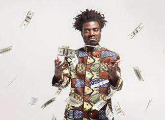 Guy throwing money in air