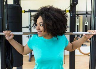 Girl at squat rack
