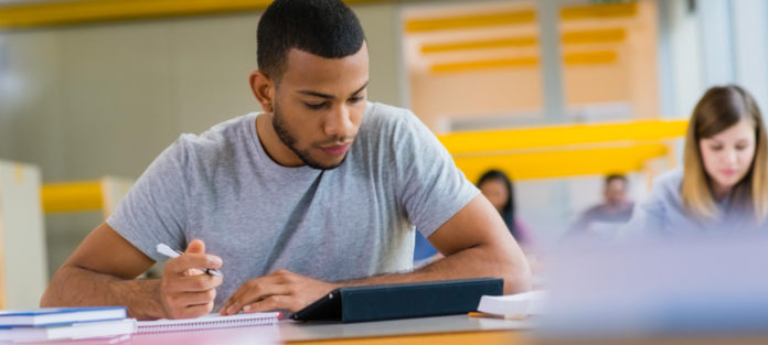 young black male taking test in classroom