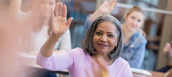 mature student raising hand