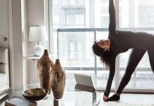 young woman stretching at home