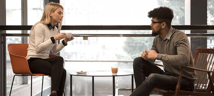 Two friends talking over coffee