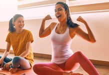 happy girls working out at home