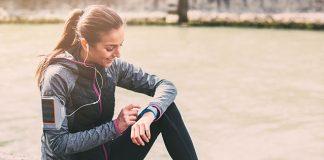 exercising girl, checking her watch