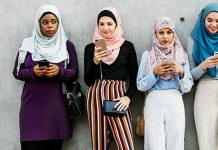 4 girls looking at phones