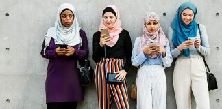 4 girls looking at phones