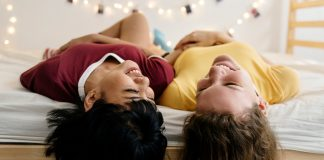 two female roommates lying on bed
