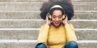 Happy girl wearing headphones