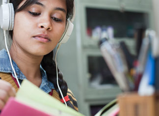 Female studying with headphones on
