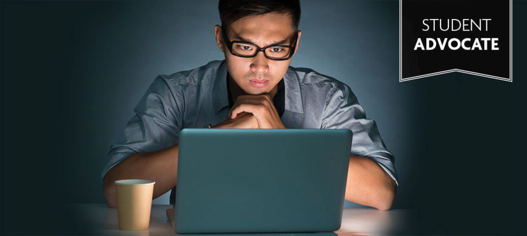 Student Advocate: Boy sitting in the dark in front of computer