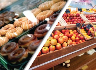 Display of donuts next to display of apples
