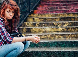 Sad girl on steps