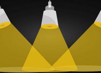 Yellow spotlights on a black background