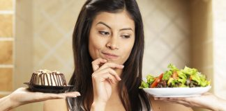 Girl choosing salad or cake